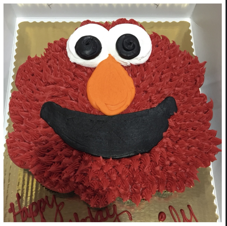 Elmo's World Birthday party cake idea featuring red Elmo face cupcake cake design.