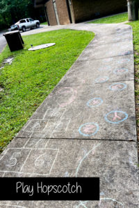 Build an extended hopscotch sidewalk chalk art obstacle course for kids to do near the bathrooms in Loop D at Shady Lake in the Arkansas Ouachita National Forest.